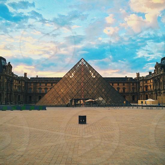 silver triangular building photo