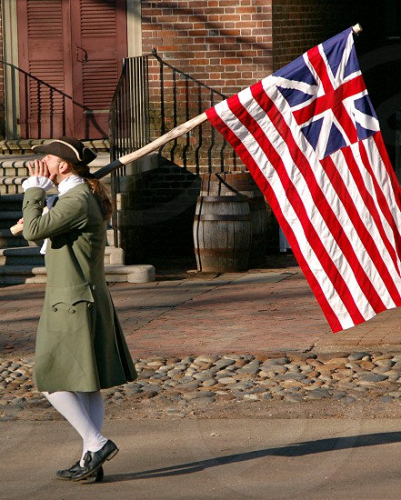 """Independence Day"" On of many authentically dressed reenactors announcing the signing of the Declaration of Independence in Colonial Williamsburg Virginia photo"