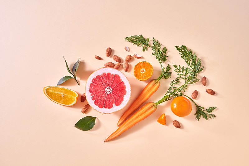 Natural organic citrus fruits vegetables - ingredients for making homemade detox smoothie on yellow paper background with copy space. Flat lay photo