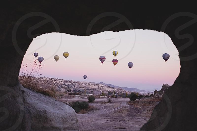 framed frame cave cappadocia hot air balloons turkey travel wanderlust explore sunrise pink sunrise waking up morning balloons photo