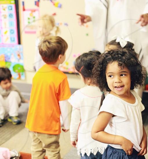 kids on white shirt photo