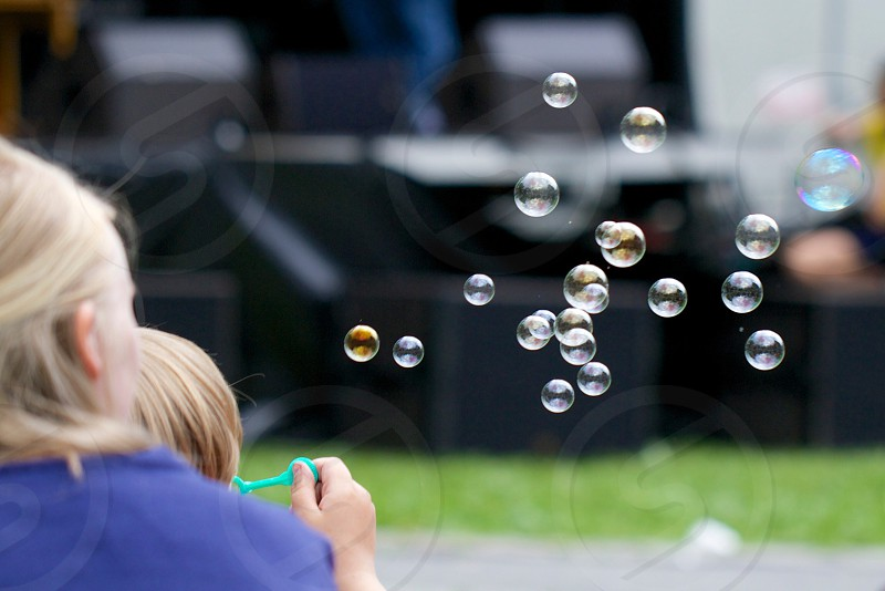 person making bubbles photography photo
