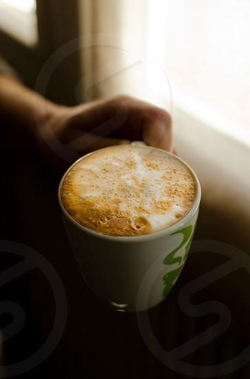 green printed wwhite ceramic mug photo