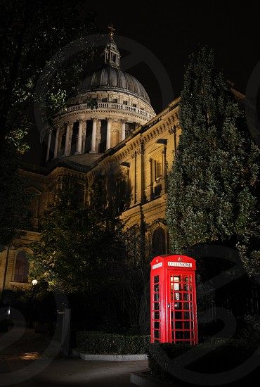 red phone booth near The British Museum in London during nighttime photo