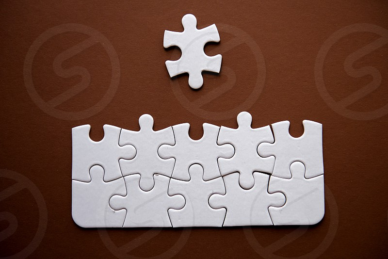 Jigsaw Puzzle Images on brown background photo