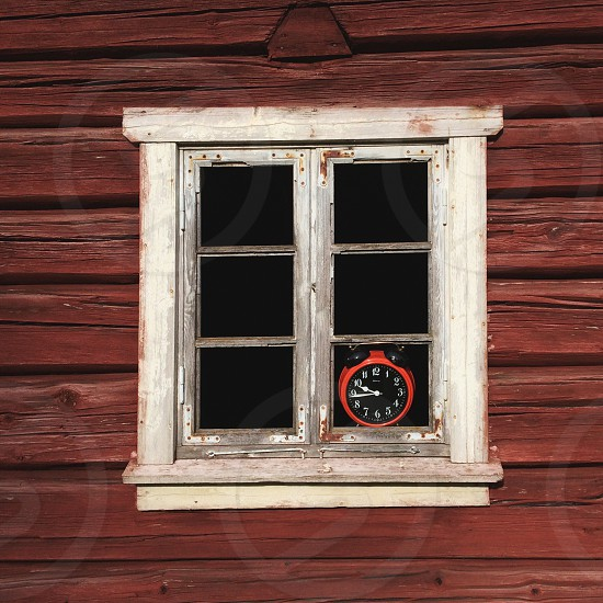 red and black analog clock reading 09:45 photo