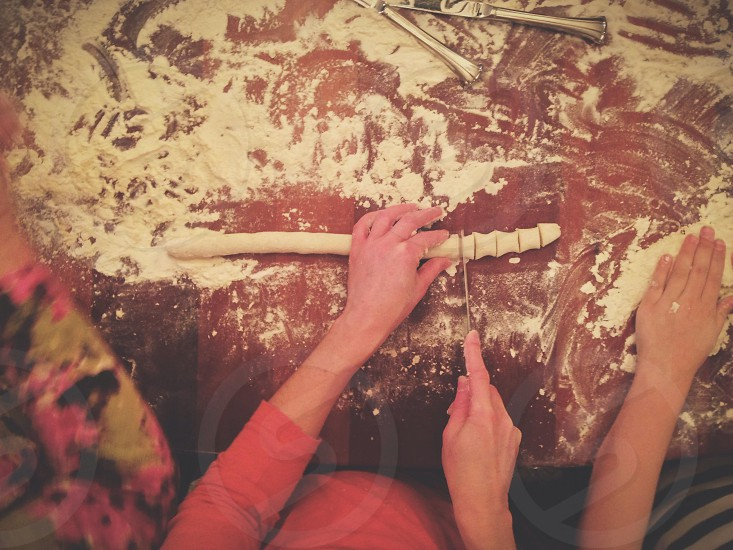 woman slicing dough photo