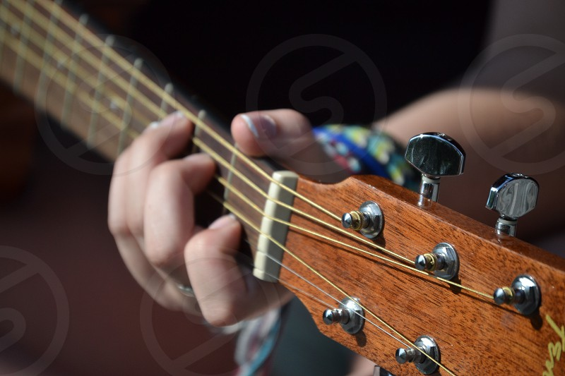 person holding guitar photo