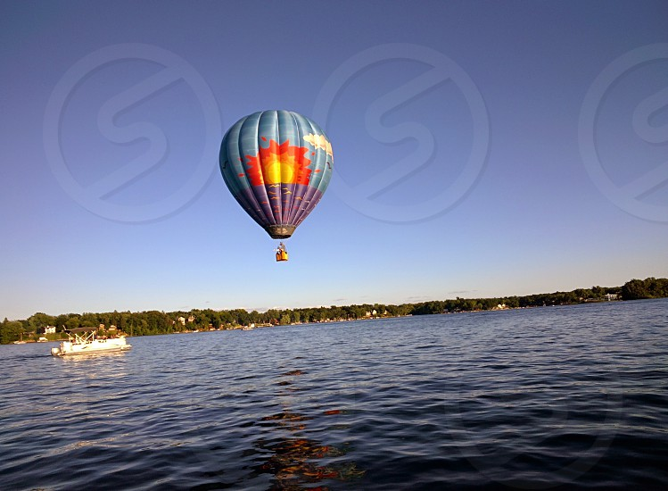 Hot-air balloon meets pontoon boat photo