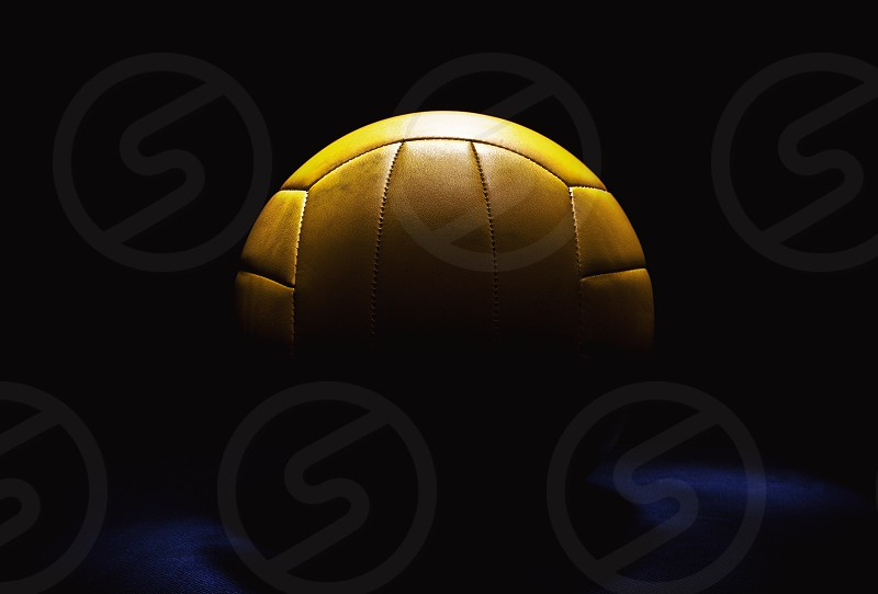 Studio composition of yellow volleyball ball closeup view. photo