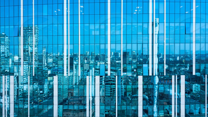 Abstract image as a reflection of style city urban futuristic architecture buildings in a glass photo