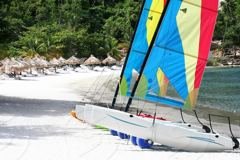 Sailing Boat on a sandy beach on the Caribbean island of Saint Lucia photo