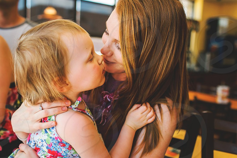 mom and daughter snuggle in a lifestyle moment photo