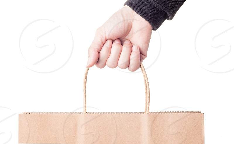 Closeup of woman holding shopiing bags photo