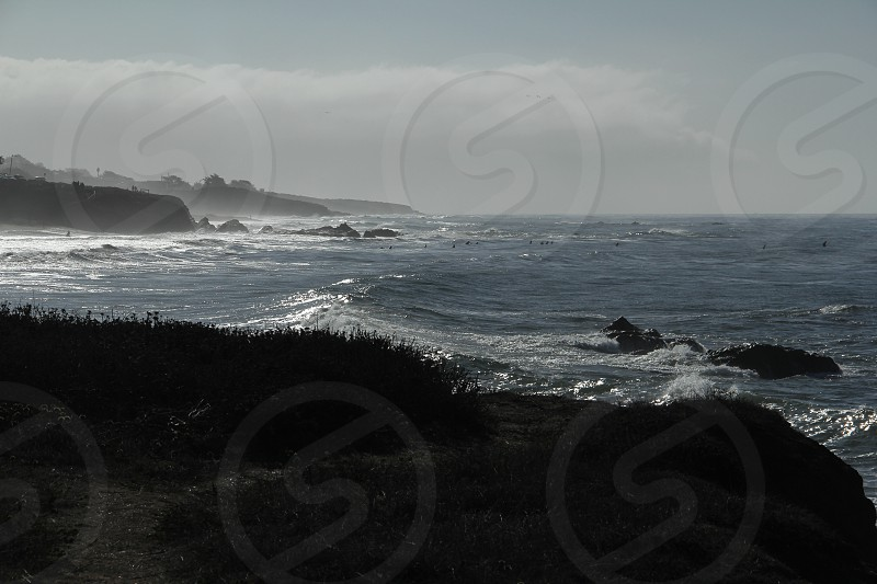 ocean waves rocks sea sea shore rugged rugged sea shore \California California central coast Cambria Cambria Californi. photo