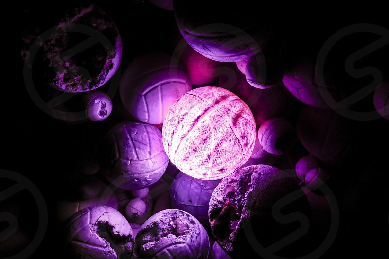 Background with colored balloons of purple and illuminated photo