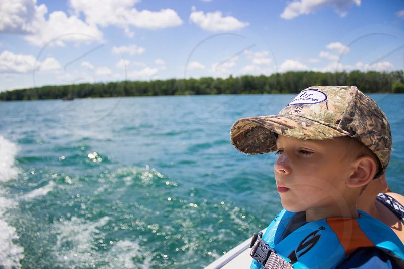 Boy on a boat photo