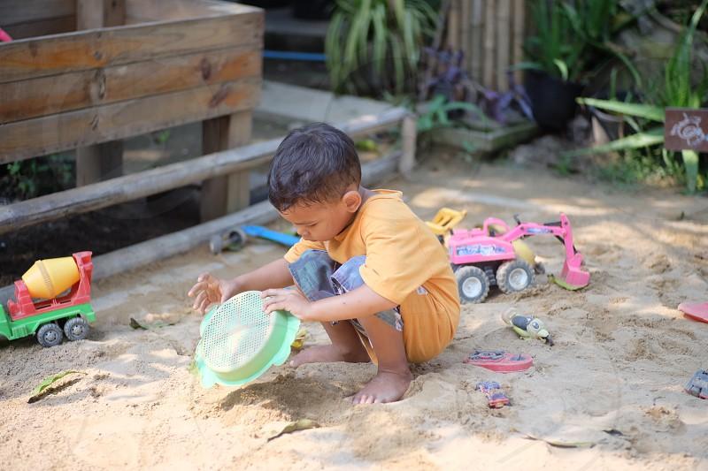 boy in a playground #sand photo
