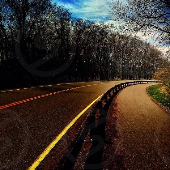 brown wooden rail beside road photo