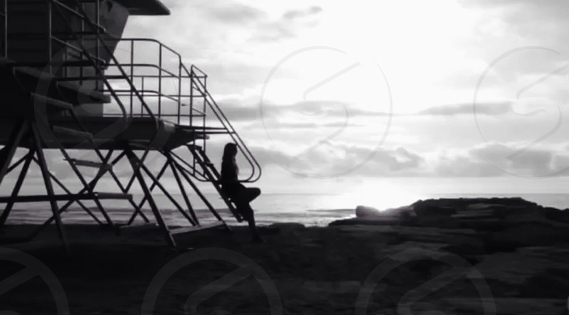 silhouette of person seated on stairs photo
