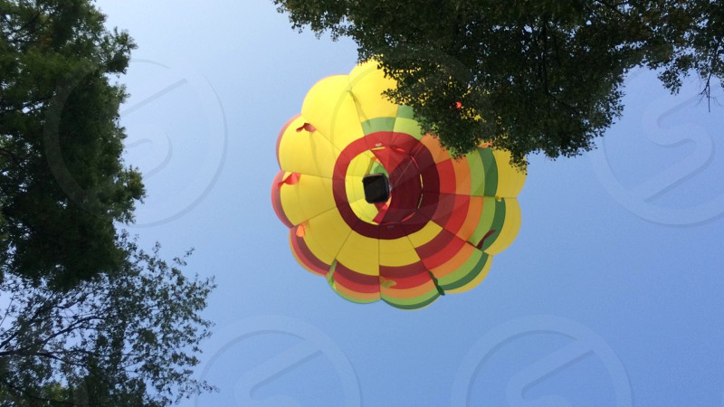 yellow and red hot air balloon during daytime photo