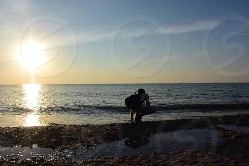 Sea traveling beach sunset photo