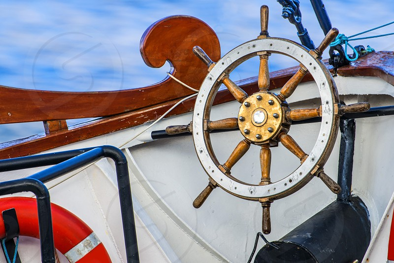 old sailing boat with wheel photo