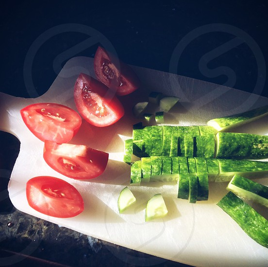 sliced tomatoes and cucumber photo
