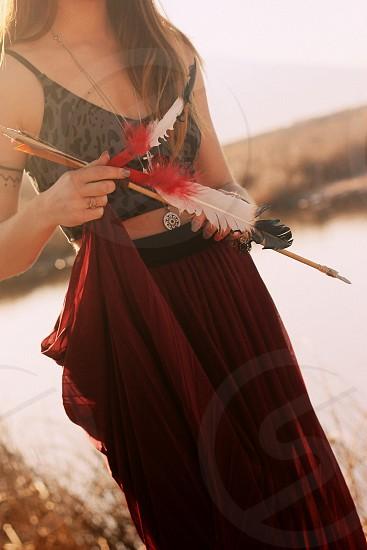 warrior arrow female model tribal maxi skirt feathers indian photo