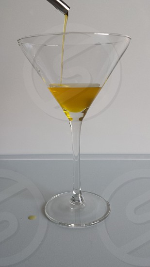 martini glass with yellow liquor photo