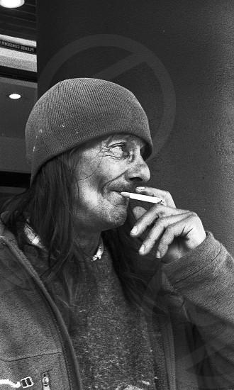 street photography portrait smoking man homeless black white film photo