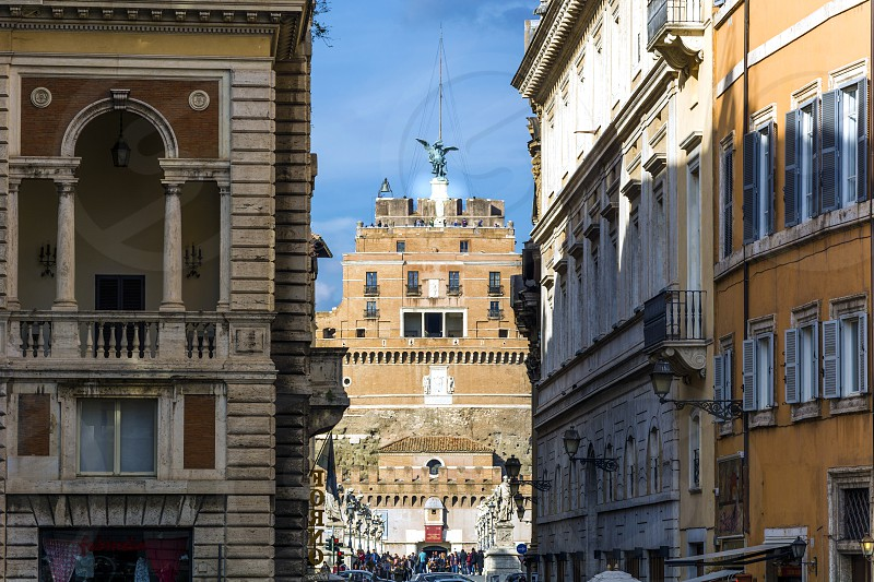 Castel Sant'Angelo viewed thorugh the medieval streets of Rome photo