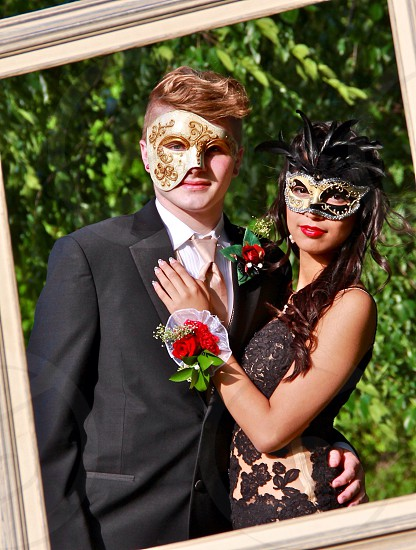 man and woman in masquerade mask photo