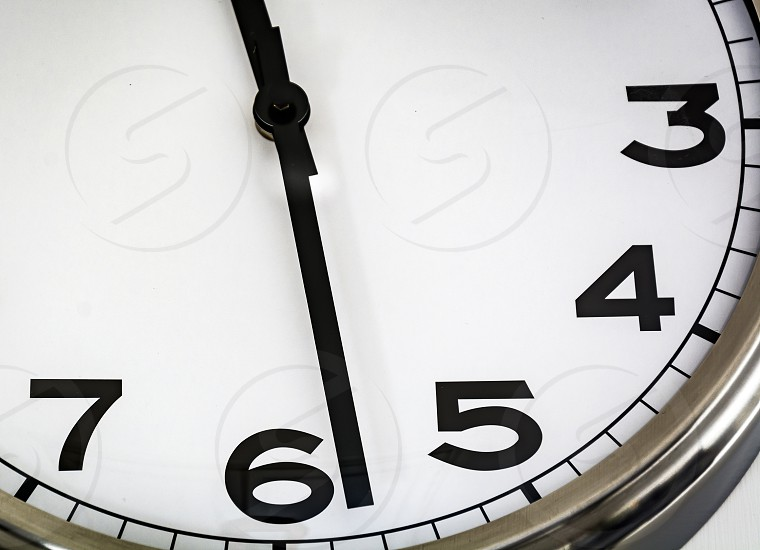 Close-up view of an white analog watch photo