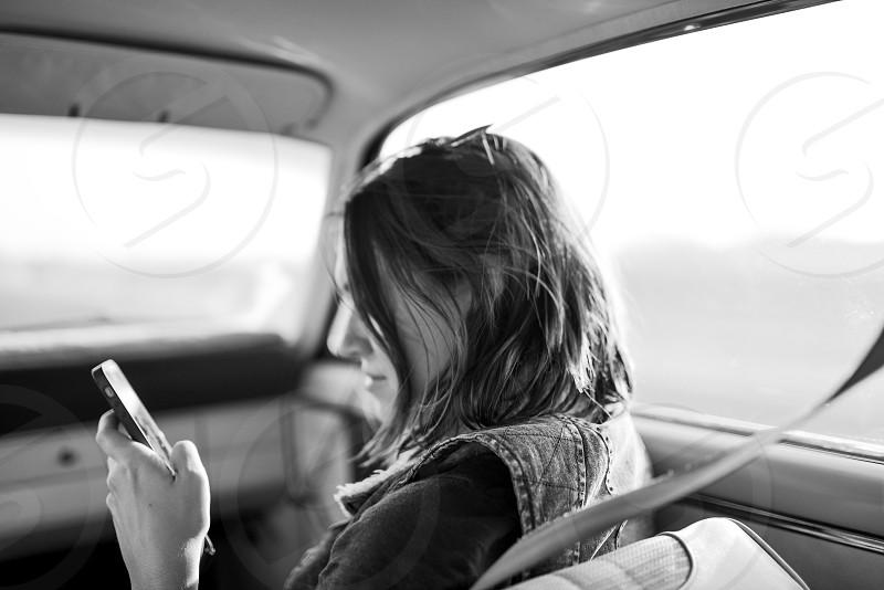 texting young woman girl car passenger phone photo