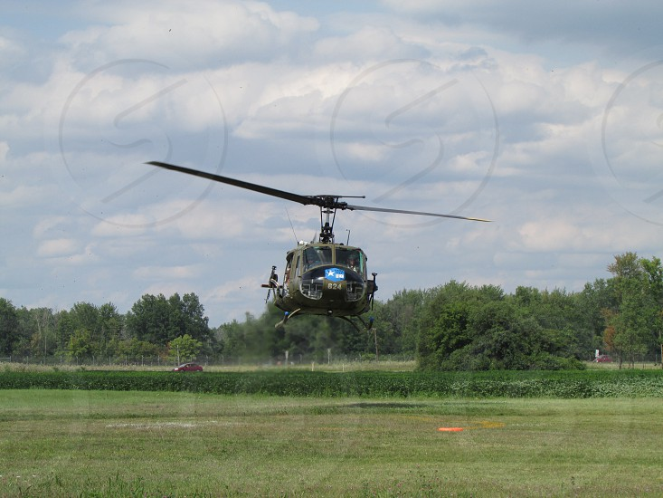 Helicopter landing during an air show. photo