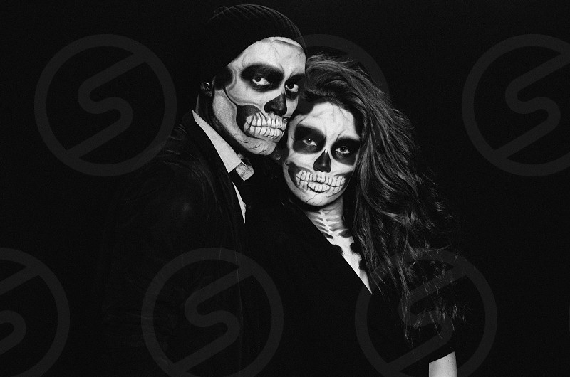 couple in black with skeleton facial paint photo