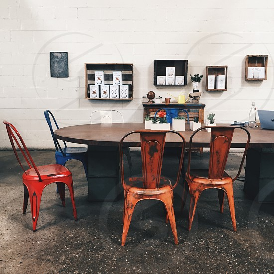 brown wooden table with four metal chairs dining set photo