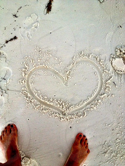 heart drawn in sand photo
