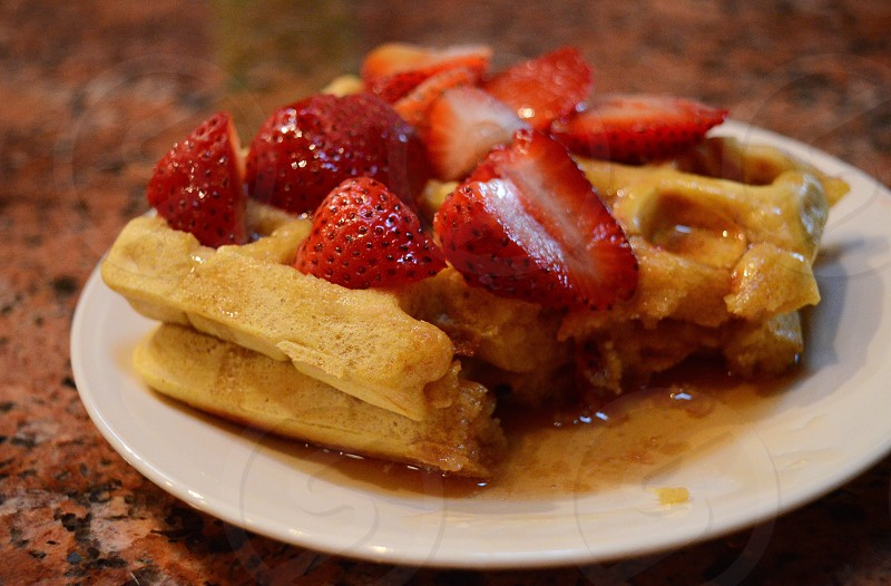 Comfort food waffles strawberries maple memory. photo
