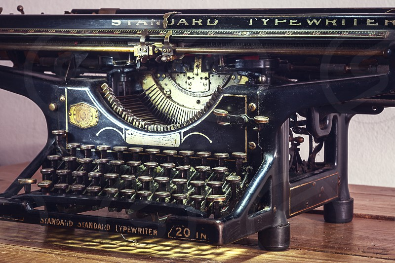 Retro design of an old typewriter dusty surfaces in good shape.  photo