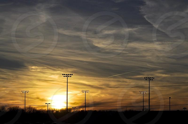 Sunset sky over sports fields photo