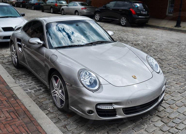 silver Porsche coupe photo