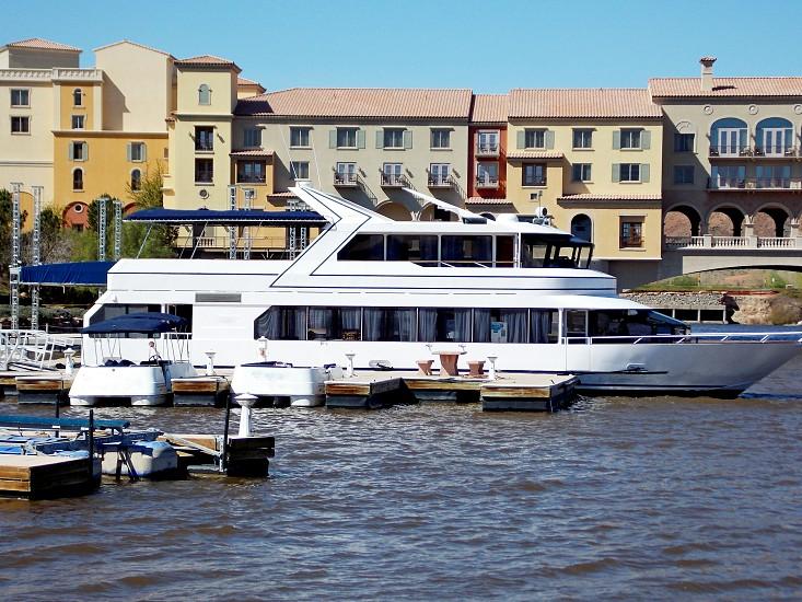 Large and small boats at dock photo