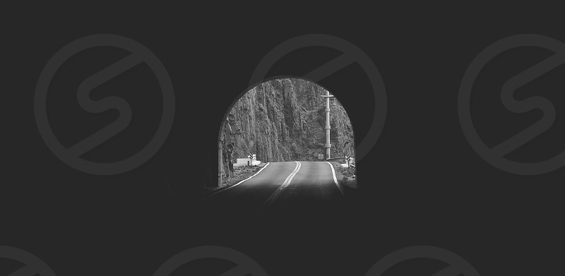greyscale road tunnel photo