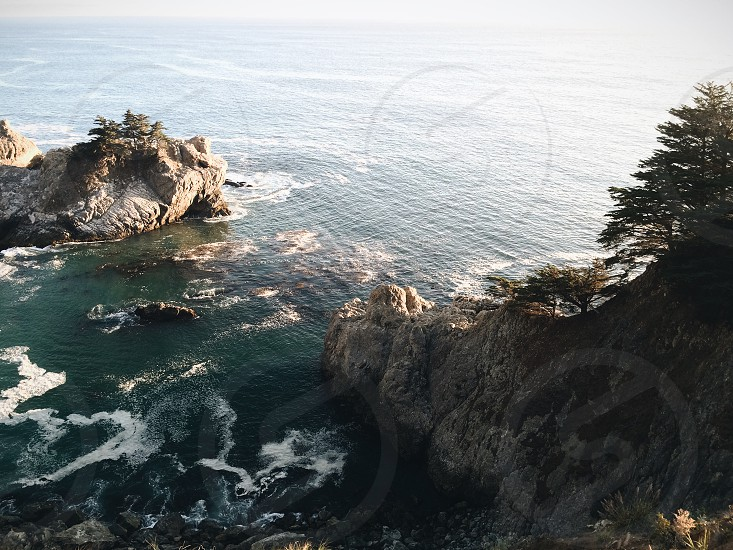 sea waves crushing on rocks photo