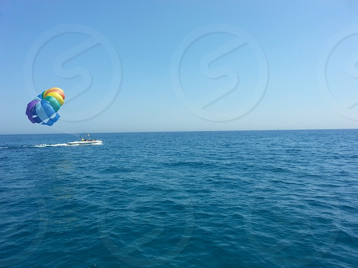 Parasailing boat in the sea photo