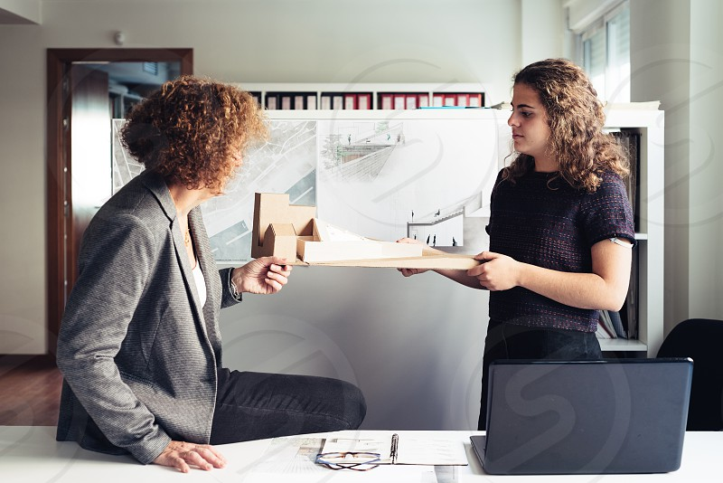 Two female architects working with architectural model in a project photo