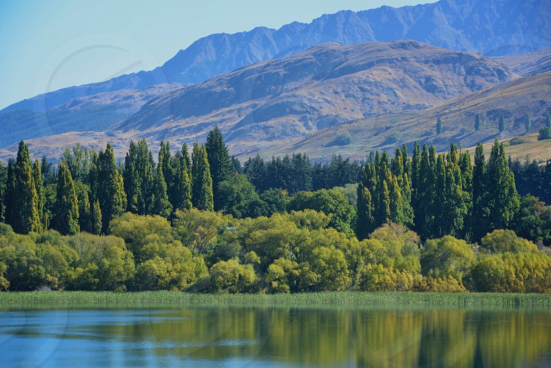 Still Water Lake Hayes in New Zealand with Mountains photo