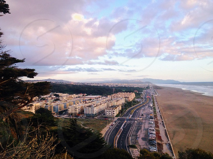 aerial sky view of city and roads near ocean at sunset purple sky photo